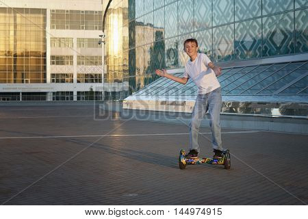 Teen rides a gyroscooter, with a smile and positive emotions