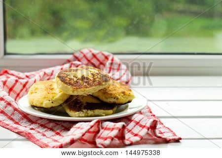 Cottage cheese pancakes, traditional Ukrainian and Russian cuisine,selective focus