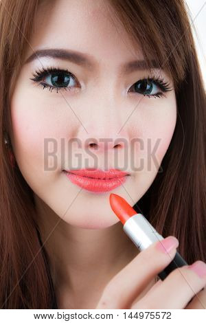 Young woman Make up with makeup lipstick