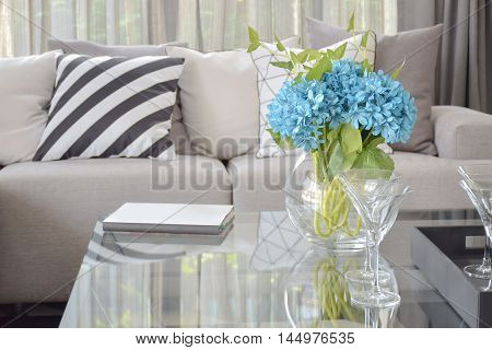 Light Blue Flower And Wine Glasses On Center Table With Striped