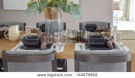 modern dining set on wooden table in modern style dining room