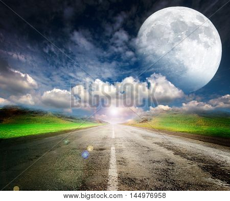 scene full moon and empty rural road