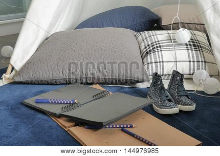 Notebooks and pillow with comfy space for creative people