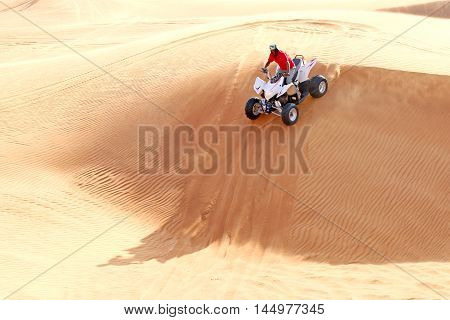 Extreme sport. ATV on the sand dunes