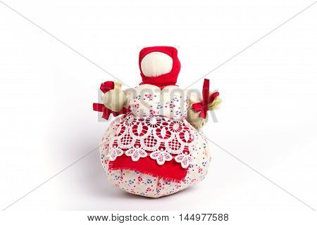 Doll amulet in national clothes on a white background