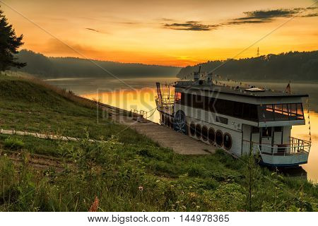 Ship In River At Sunset