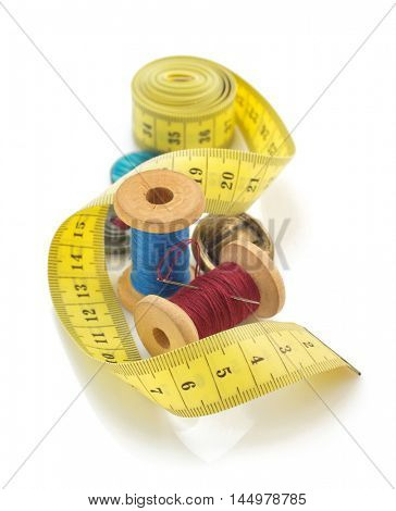 sewing tools and measuring tape isolated on white background