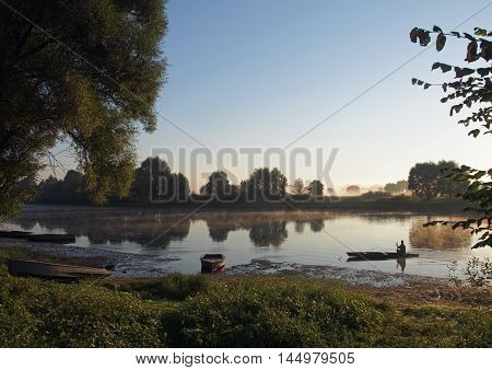 View of the river in the early summer morning