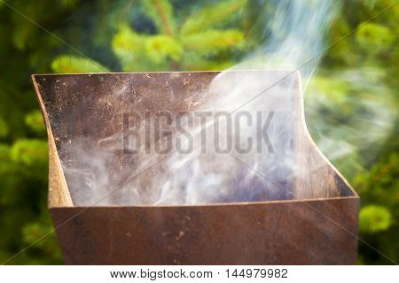 The smoke from the brazier in the process of cooking meat