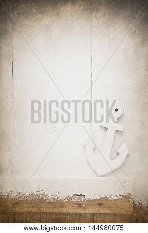 Vintage background with an white anchor.