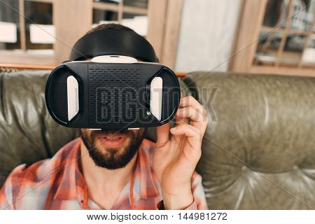 Man try vr glasses first time, close-up. Test of new innovational device for entertainment, free space. Modern technology, innovation, cyberspace, entertainment concept