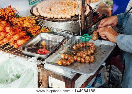 Thai Woman Cooks Meatballs