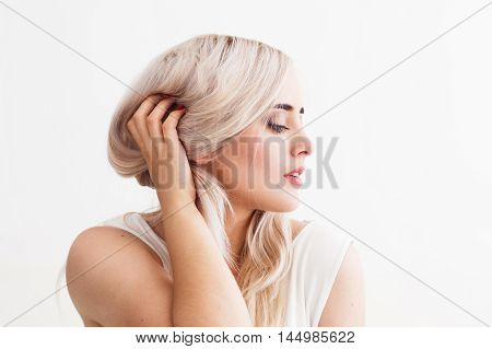 Beautiful blond woman with bad hair. Concept of haircare, dyed hair, cosmetics and masks. Female beauty