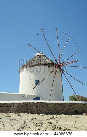 Mykonos, Greece. Traditional windmill before blue sky. The windmills are the island's landmark.