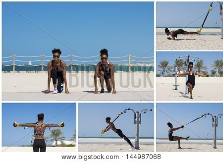 Two young females of african ethnicity train outside at Dubai beach. Outdoor workout with suspension trainer. Healthy lifestyle concept