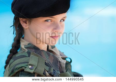 Young Girl In Army Ammunition