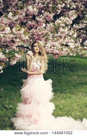 Woman In Pink Dress Near Bloom