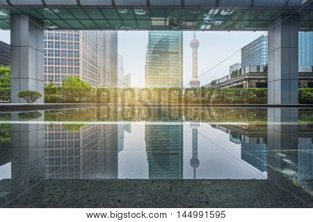 oriental pearl tower reflected at modern architectural floor