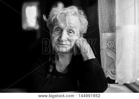 Black and white portrait of an elderly woman, close-up.