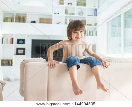 Cute little kid at home alone