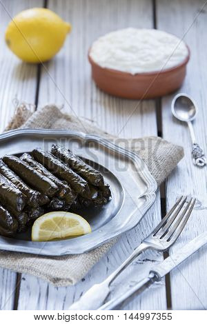 turkish dolmades with natural light on wooden table