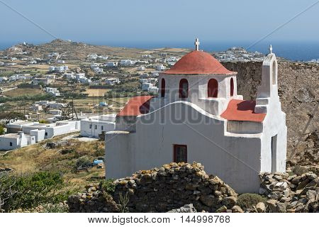 Landscape with medieval fortress and White church, Mykonos island, Cyclades, Greece