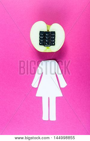 Alphanumeric apple with humanoid body on pink wooden background