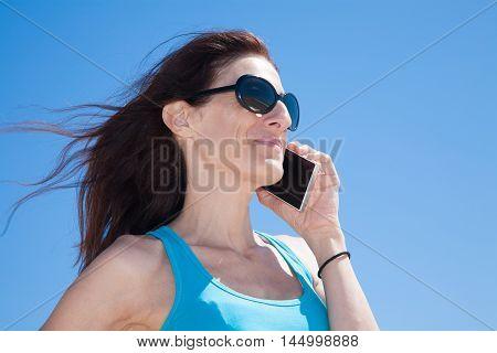 Blue Shirt Profile Woman Talking On Mobile Phone