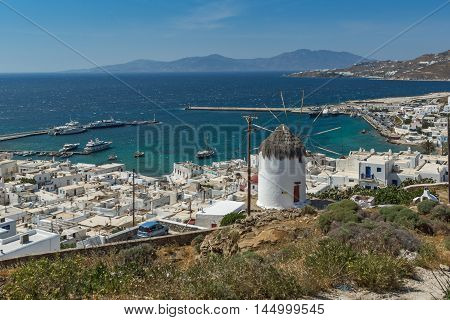 Amazing Seascape of white windmill and Panorama to island of Mykonos, Cyclades, Greece