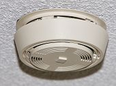 stock photo of stippling  - Smoke detector mounted on a stippled ceiling - JPG