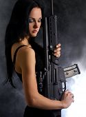 stock photo of girls guns  - Sexy woman with weapon on smoky background - JPG