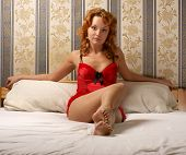 stock photo of moulin rouge  - Moulin Rouge lady on the bed - JPG