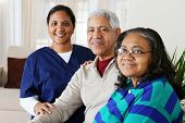 stock photo of elderly couple  - Home health care worker and an elderly couple - JPG