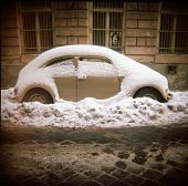 stock photo of beetle car  - Toy camera image of a VW Beetle covered in snow - JPG