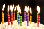stock photo of birthday-cake  - happy birthday cake shot on a black background with candles - JPG
