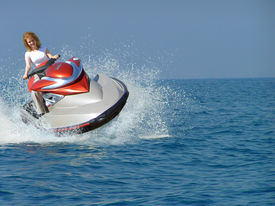 pic of waverunner  - Young woman riding a jet ski on the Mediterranean Sea - JPG