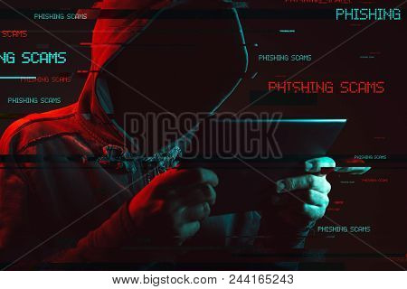 poster of Phishing Scams Concept With Faceless Hooded Male Person, Low Key Red And Blue Lit Image And Digital
