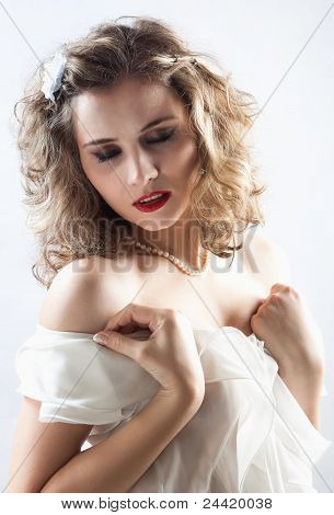 Young girl in white dress dancing