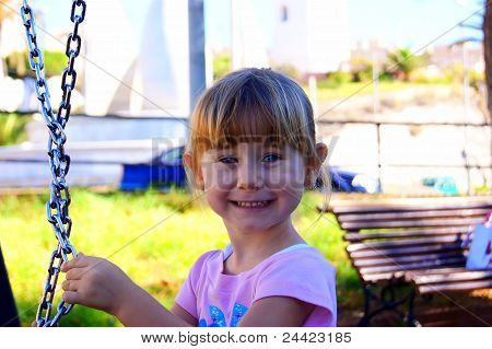 The girl near a swing