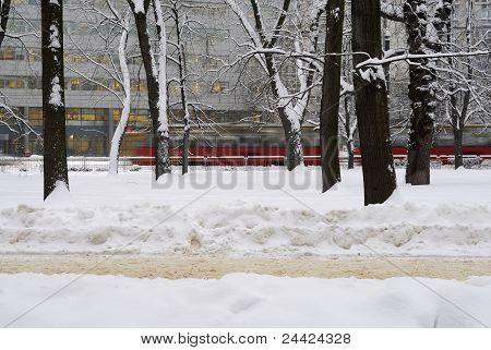 Tram Rushing By Trees In Winter Scene.