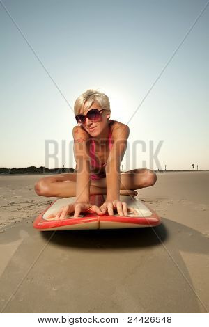 Young Blonde Woman At The Beach Surfing And Enjoying Herself