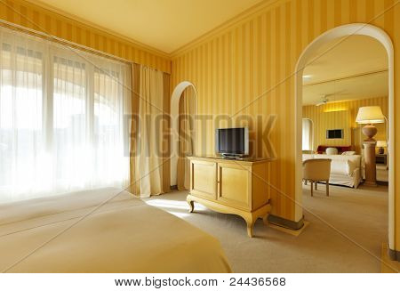 interior luxury apartment, view of living room from the bedroom
