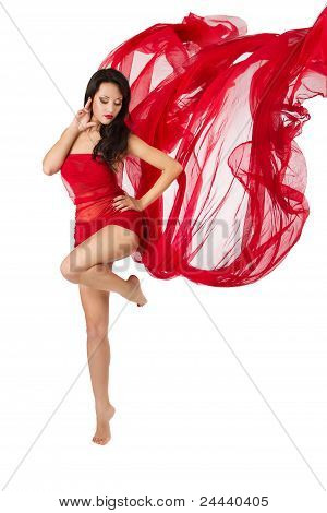 Woman Dancing In Red Flying Waving Dress  On A Wind Flow. Over White Background