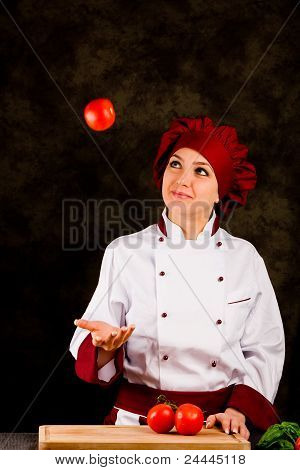 Chef Juggling With Tomato