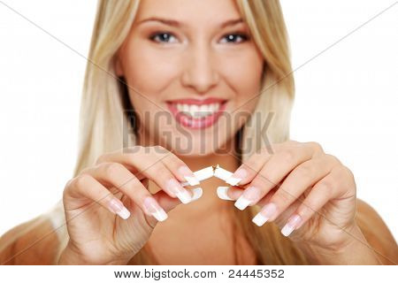 Young beautiful blond smiling woman breaking cigarette, isolated on white