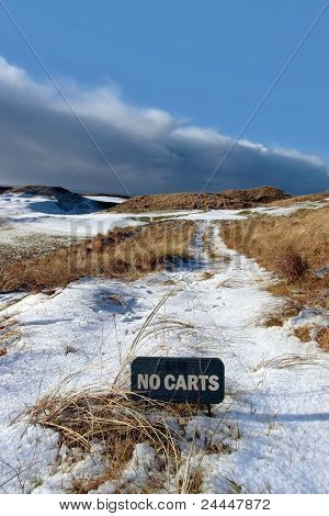 No Carts Sign On A Snow Covered Links Golf Course