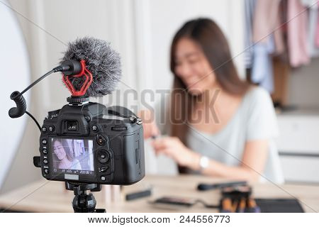 Asian Young Female Blogger Recording