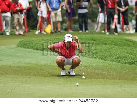 KUALA LUMPUR, MALAYSIA - OCTOBER 16: Yani Tseng of Chinese Taipei lines up a putt at the green of hole #18 during the Sime Darby LPGA 2011 golf tournament on Oct 16, 2011 in Kuala Lumpur, Malaysia.