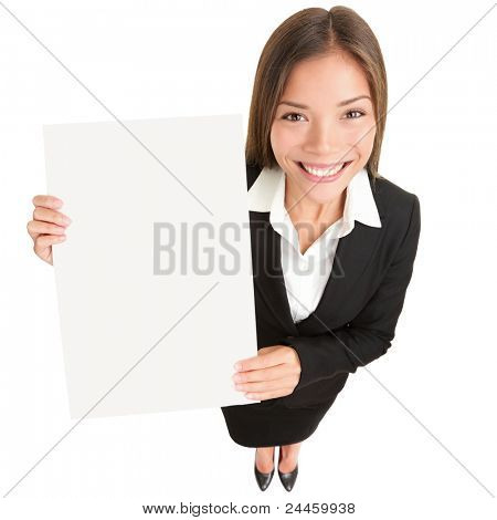 Business woman showing sign. Young Asian businesswoman in suit showing blank sign poster with copy space. Beautiful young female model isolated on white background in full length.