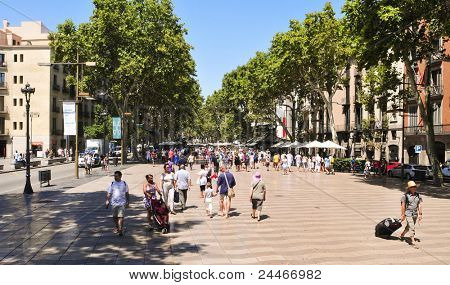 BARCELONA, SPAIN - AUGUST 16: La Rambla on August 16, 2011 in Barcelona, Spain. Thousands of people walk daily by this popular 1.2 kilometer-long pedestrian mall.